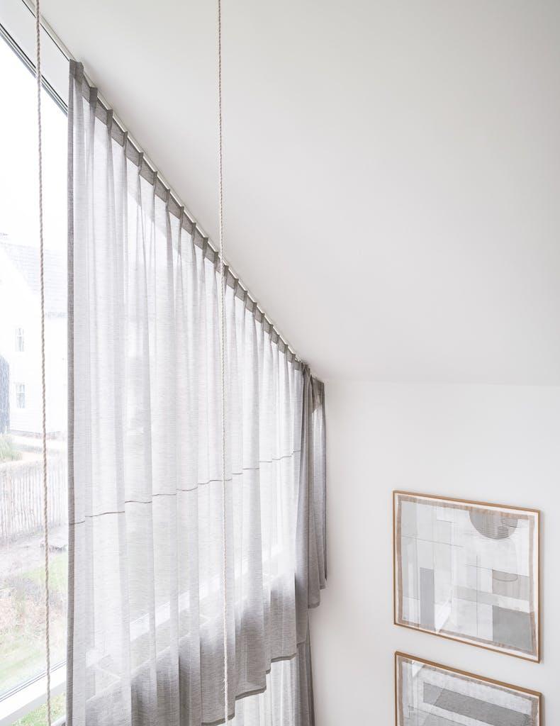 Gordijnen schuin raam
